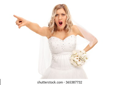 Studio shot of an angry bride pointing with her finger isolated on white background