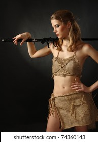 studio shot of Antique clothing young warrior woman holding sword in her hand