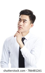 studio shot of an asian business man looking up thinking hand on chin, isolated on white background.