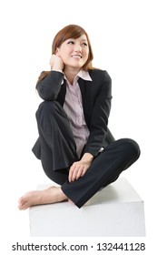 Studio shot of attractive Asian business woman sit on white box, element for designer for sit and rest concept.