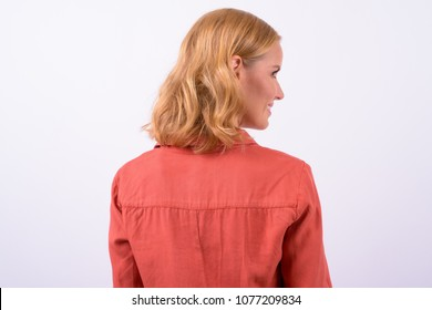 Studio shot of beautiful blonde businesswoman against white background