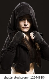 Studio shot of a beautiful serious woman getting ready to fight.