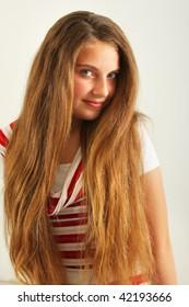 Studio shot of a beautiful smiling successful young girl