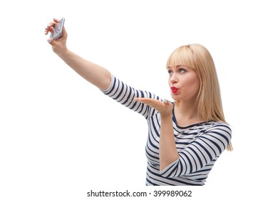 Studio shot of beautiful young blonde woman on white background. Woman making selfie on vintage camera