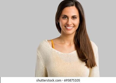 Studio shot of a beautiful young woman smiling