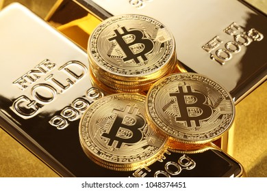 Studio shot of  Bitcoin and gold nugget .Digital virtual currency