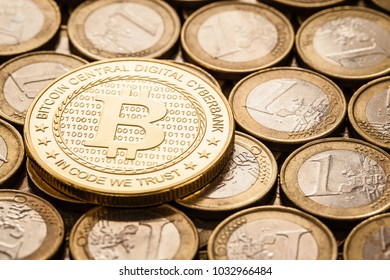 Studio shot of a bitcoin physical golden coin leaning over a stack of euro coins. Bitcoin is a blockchain crypto currency