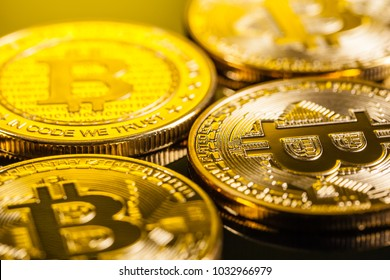Studio shot of a bitcoin physical golden coin on a dark background. Bitcoin is a blockchain crypto currency