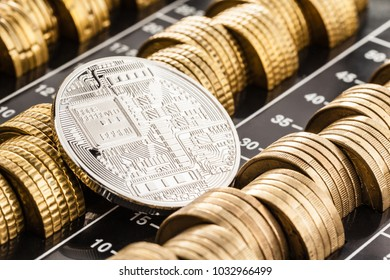 Studio shot of a bitcoin physical silver coin leaning over a stack of euro coins. Bitcoin is a blockchain crypto currency