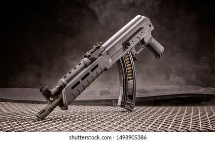 Studio shot of a black AK47 on a grey background.