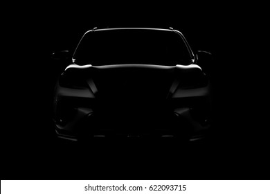 Studio shot of black car isolated on black background