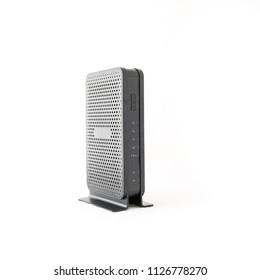 Studio shot of black wireless router cable modem isolated on white background. Front view with indicator lights
