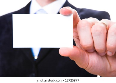 A studio shot of a businessman holding out a blank business card. Room for text, or your own message.