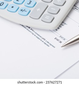 Studio shot of calculator and pen over some receipt - accounting concept