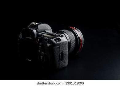 Studio shot Canon 5D mark IV on black background. Canon 16-35mm f/2.8 L II USM lens attached to the camera body.