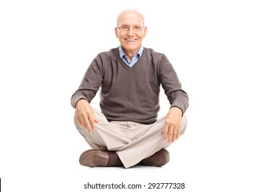 Studio shot of a cheerful senior sitting on the floor and looking at the camera isolated on white background