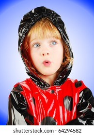 studio shot with child portrait  with red raincoat isolated on the gradient  background.