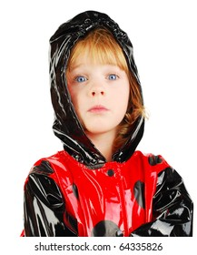 studio shot child portret with funny face in  red raincoat isolated on the white background.