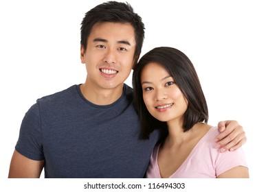 Studio Shot Of Chinese Couple