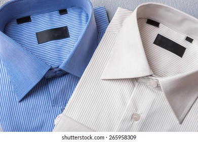 Studio shot of couple of man's shirts on a grey background