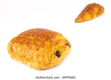 Studio shot of a croissant and a pain au chocolat.