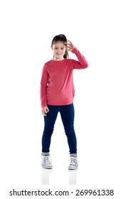 Studio shot of cute little girl showing ok sign with her hand on white background