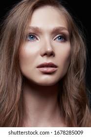 Studio shot of cute young woman. Close-up portrait of the beautiful girl