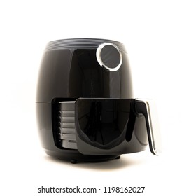 Studio shot of digital air fryer with open non-stick basket handle isolated on white background