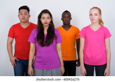 Studio shot of diverse group of multi ethnic friends standing together