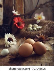 studio shot of eggs on a vintage wooden background.