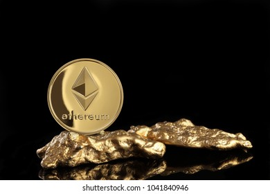 Studio shot of ethereum on gold nugget .Digital virtual currency