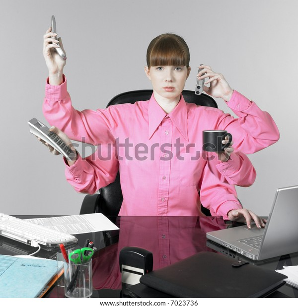 studio shot of a expressive and funny red hair young woman at the office desk having a hard time