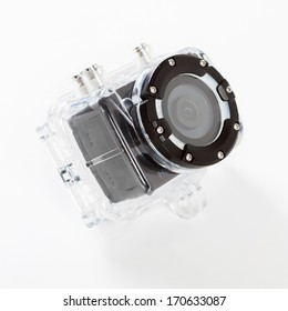 A studio shot of a extreme camera in a waterproof housing on a white background.