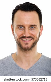 Studio shot of face of happy young man smiling