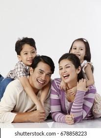 studio shot of family laughing