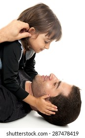 Studio shot of a father and his daughter