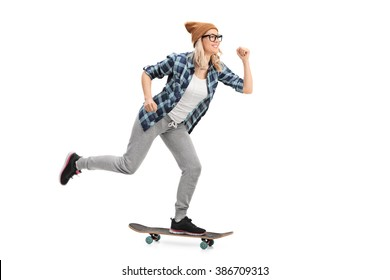 Studio shot of a female hipster riding a skateboard isolated on white background