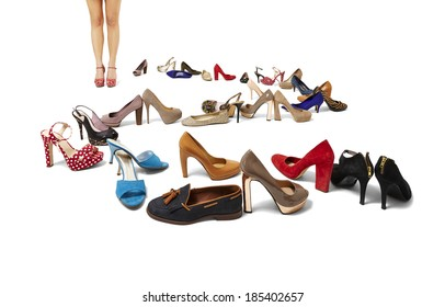 Studio shot of female legs and huge selection of shoes. Copy space.