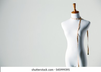 studio shot of female mannequin with measuring tape