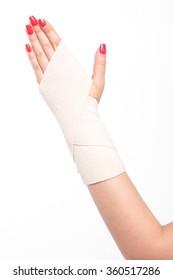 studio shot female wrists tied with an elastic bandage.