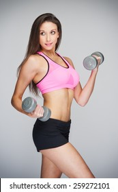 Studio shot of fitness training model lifting weights.