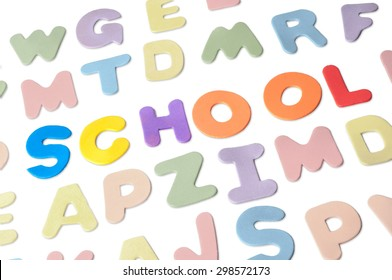 Studio shot of foam capital letters forming the words Back To School, isolated on white background.