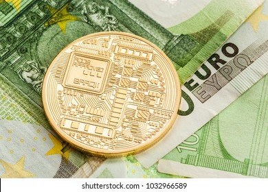 Studio shot of a generic cryptocurrency physical golden coin on 100 euro bills banknotes. Bitcoin is a blockchain crypto currency