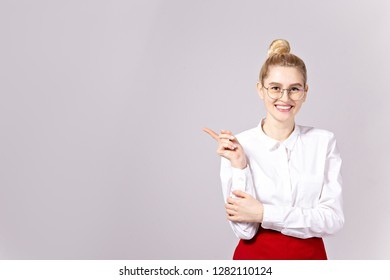 48dda9b13 Studio shot of gorgeous young blonde business woman wearing round eyeglasses,  white cotton blouse top