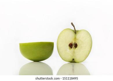 Studio shot of green apple cut in half showing seeds