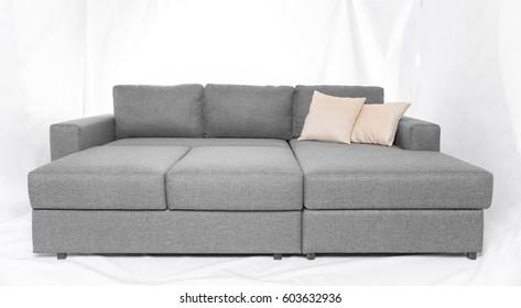 Studio shot of a grey modern sofa isolated on white background
