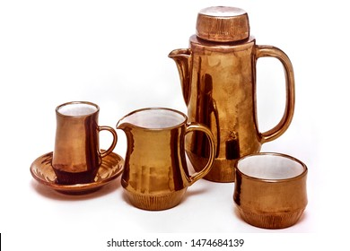 Studio Shot of Hand Made Metallic Copper Glaze Coffee Set on White Background
