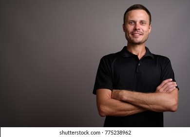 Studio shot of handsome man against gray background