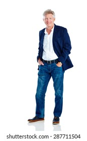Studio shot of handsome mature man posing in smart casuals on white background