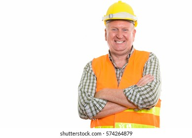 Studio shot of happy mature man construction worker smiling with arms crossed